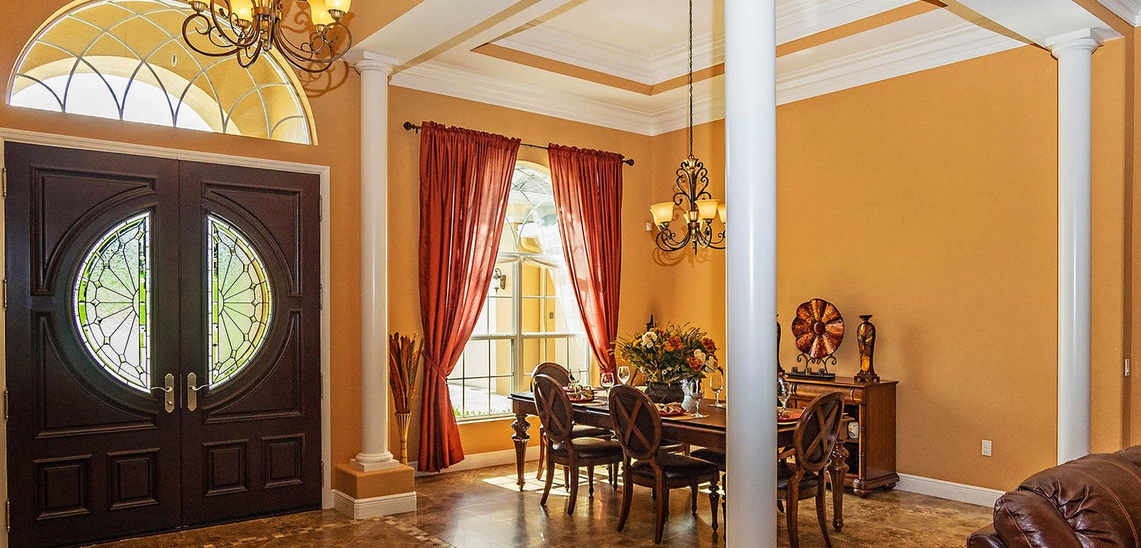 Dining room with big window and orange wall