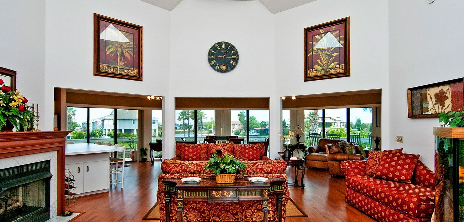 Living room with tree big windows and red sofa